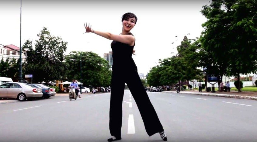 Fig 1. Studio Revolt (Anida Yoeu Ali and Masahiro Sugano; collaborative formed in 2011), DANCE: election, anxiety and a vacant street in Phnom Penh, 2013. Directed & edited by Masahiro Sugano, performed by Mandy Liu. Image courtesy of Studio Revolt.