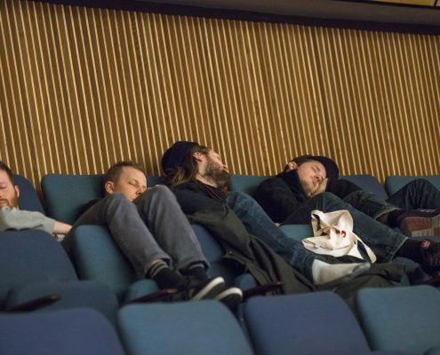 Students fallen asleep at the Learning Place, part of: Documents, Constellations, Prospects. Former West Research Congress, 2013, House of the Cultures of the World, Berlin © Marcus Lieberenz.